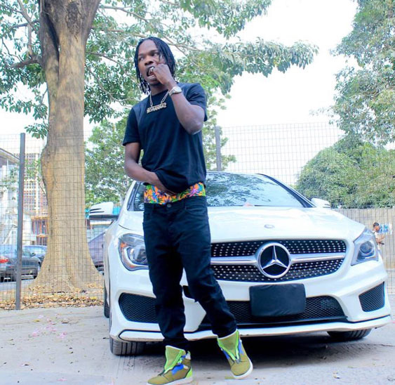 Naira Marley with Mercedes Benz